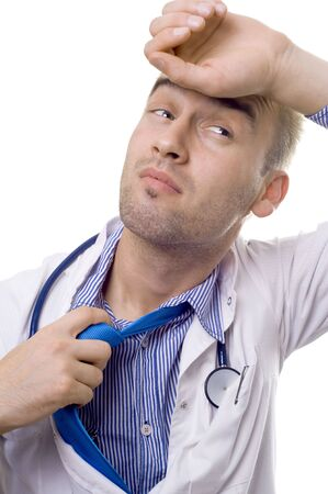 portrait of an overworked young male doctor Standard-Bild