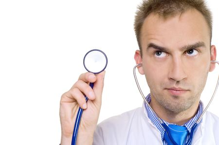concerned young male doctor holding stethoscope in hand