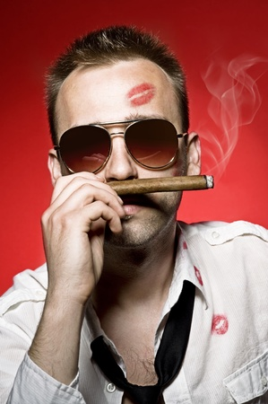young handsome man with cigar and lips imprints photo