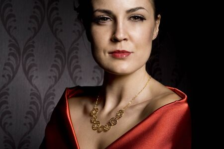woman wearing golden necklace over wallpaper background Standard-Bild