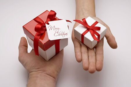 chritmas gifts on hands on white backround photo
