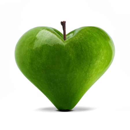 heart shaped: heart shaped fresh green apple over white Stock Photo
