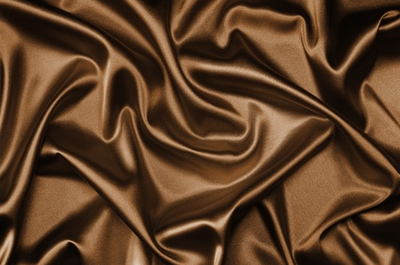 drape: textile brown silk background draped in waves Stock Photo