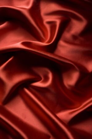 textile red satin background draped in waves