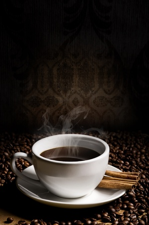 hot cup of coffee, bean and aromatic cinnamon Standard-Bild