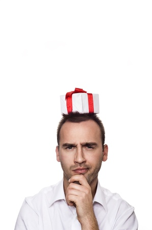 young handsome man with a gift on his head, over white background photo