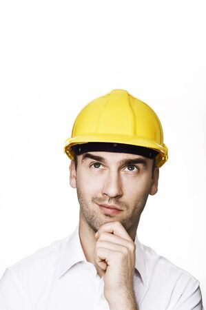 young male engineer looking up, over white background