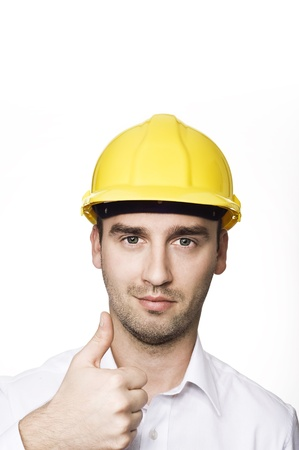 honest: young male engineer with thumb up, over white background Stock Photo