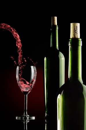 two bottles and a glass of wine over gradient backround Standard-Bild