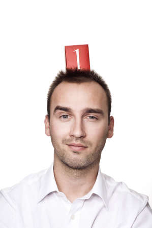 young caucasian male with number one on his head, over white background