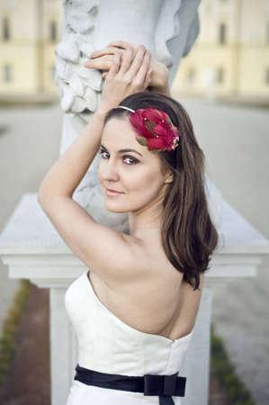 smiling brunette bride with fashionable stylish headpiece photo