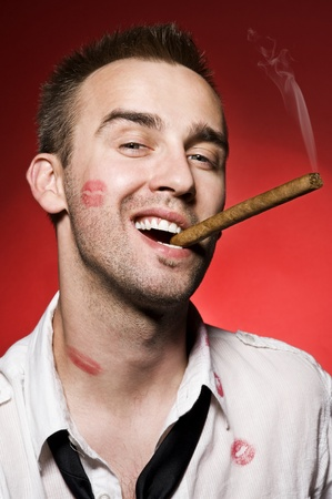 portrait of young confident man smoking cigar photo