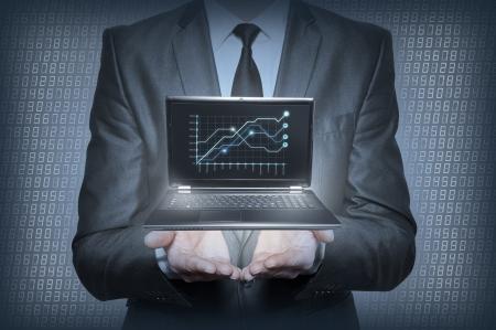 Graph in the hands of businessmen Standard-Bild