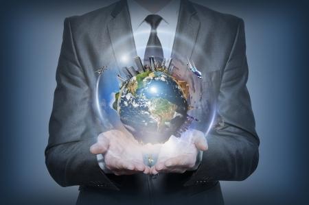 Planet earth in human hands on blue background Standard-Bild