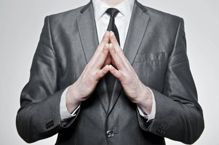 successfull businessman folding his hands together, over white background