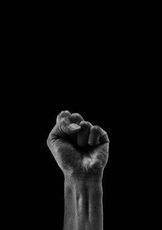 Lented fist isolated on black background,copy space,BLACK LIVES MATTER 版權商用圖片