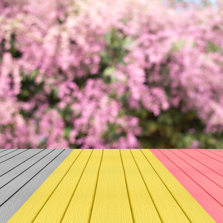 Perspective belgium flag color wood over blur trees with bokeh background, spring and summer season