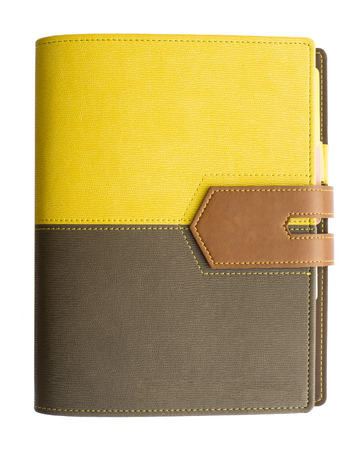 Leather yellow-black cover notebook isolated on white background photo