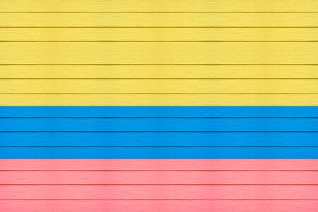 colombia flag: colombia flag on horizontal wood background.