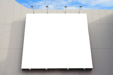 billboard advertising: Blank poster board wall in modern shopping mall on a cloudy day.