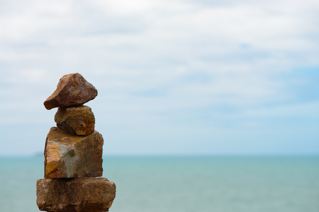 smooth stones: Stack of round smooth stones on a seashore.