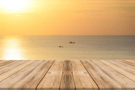 Vintage wooden board empty table in front of sunset background. Perspective wood floor over sea and sky - can be used for display or montage your products. beach  summer concepts.