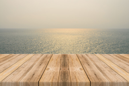 Vintage wooden board empty table in front of sea  sky background. Perspective wood floor over sea and sky - can be used for display or montage your products. beach  summer concepts.