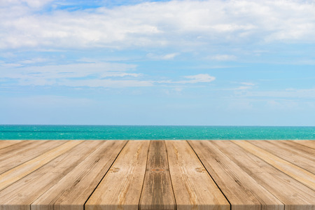Vintage wooden board empty table in front of blue sea  sky background. Perspective wood floor over sea and sky - can be used for display or montage your products. beach  summer concepts.