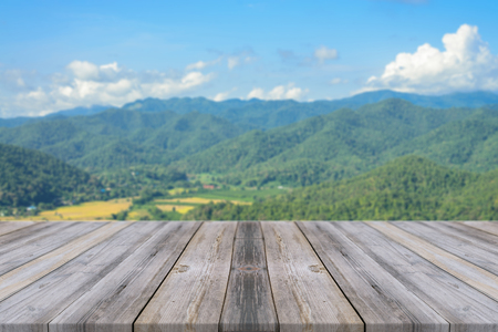 perspectives: Wooden board empty table in front of blurred background. Perspective grey wood over blur mountain in forest - can be used for display or montage your products. spring season. vintage filtered image.