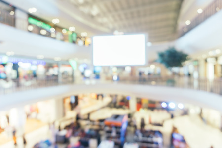 Blurred background : Store of shopping mall blur background with bokeh. vintage filtered image. 写真素材