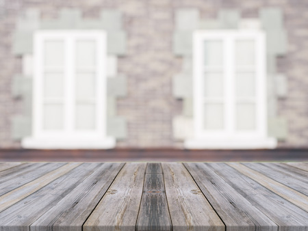 website window: Wooden board empty table in front of blurred background. Perspective grey wood over blur ceramic tile brick wall in background - can be used for display or montage your products.