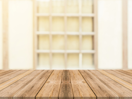 Wooden board empty table in front of blurred background. Perspective brown wood over blur in coffee shop - can be used for display or montage your products.Mock up for product.Vintage filter.