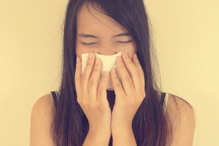 grippe: Flu cold or allergy symptom. Vintage filtered image.