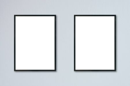 amaged: Mock up blank frame hanging on wall in room