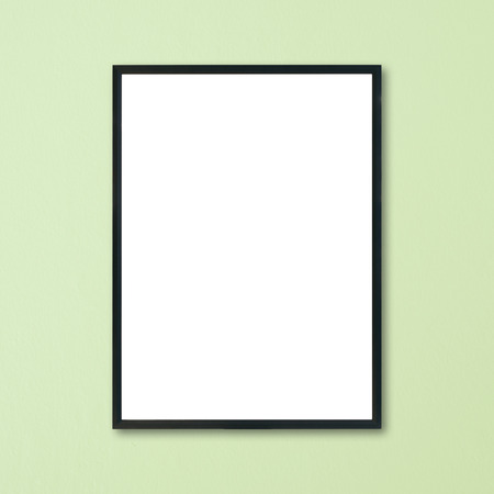 amaged: Mock up blank frame hanging on wall in room.