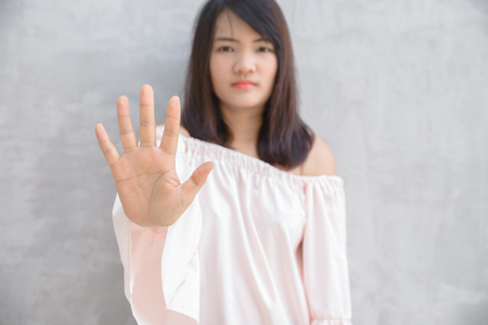 restrain: Young woman showing her denial with NO on her hand Stock Photo