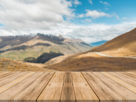 table mountain national park: Wooden board empty table in front of blurred background. Perspective brown wood table over blur mountain landscape background - can be used mock up for display or montage your products.