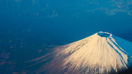 Beautiful Fuji Mountain viewed from airplane in early winter season.