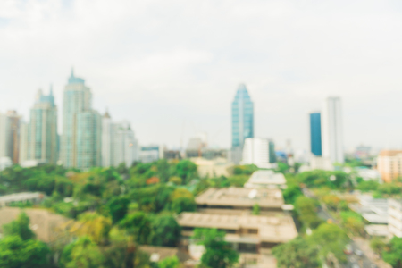 city park skyline: Blurred industrial city backgrounds - Blur of Bangkok city town with sunset and twilight sky and bokeh light view form roof top of building. Blur backgrounds concept.