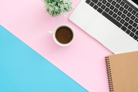 Minimal work space - Creative flat lay photo of workspace desk. Top view office desk with laptop, notebooks and coffee cup on pastel color background. Top view with copy space, flat lay photography.