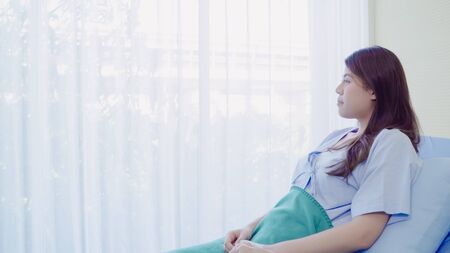 Beautiful Asian patient sick and sleeping while staying on Patient's bed at hospital. Medicine and health care concept. 写真素材