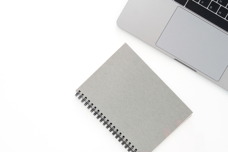 Creative flat lay photo of workspace desk. Top view office desk with laptop and notebook on white color background. Top view with copy space, flat lay photography. Stock Photo