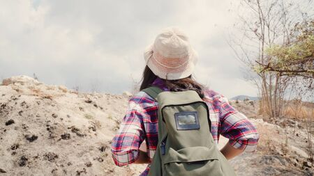 Hiker Asian backpacker woman walking to top of mountain, Female enjoy her holidays on hiking adventure feeling freedom. Lifestyle women travel and relax in free time concept.