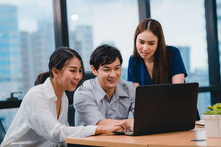 Collaborative process of multicultural businesspeople using laptop presentation and communication meeting brainstorming ideas about project colleagues working plan success strategy in modern office. Stock fotó