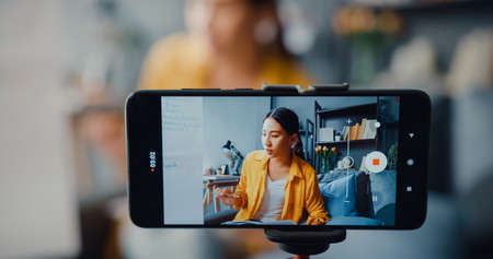 Young Asia lady english teacher video call on smartphone talk by webcam learn teach in online chat at home. Remote classroom, Social distance, quarantine for corona virus prevention. Close up screen.