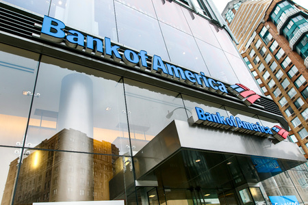 above 21: New York, January 21, 2017: Bank of America signage on a glass facade of a building above the entrance to their branch. Editorial