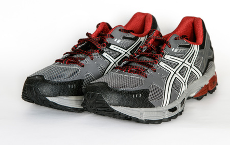 New York, December 02: A pair of brand new Asics running shoes isolated on white. Editorial