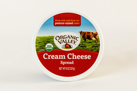 New York, December 17, 2016: A tub of Organic Valley cream cheese spread is seen against white background.