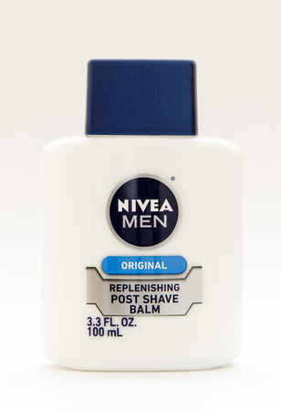 New York, January 25, 2017: A bottle of Nivea post shave balm stands against white background. Sajtókép