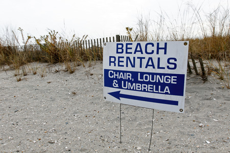 rentals: Beach Rentals sign on a deserted beach during winter.